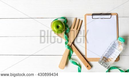 Planning For Diet Health Eat And Food.  Green Apple And Measuring Tape, Note Pad For Fitness Style.