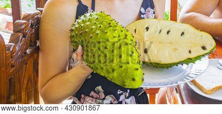 Woman Holds Sliced Soursop Sauersack Tropical Fruit In Sri Lanka.