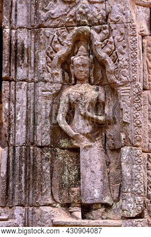 Detail Of Bas Relief Sculpture The Wall Of The Ancient Ta Prohm Temple In The Angkor Thom Area, Siem