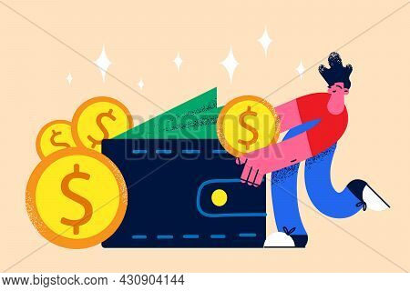 Wealth And Money In Pocket Concept. Positive Man Standing And Taking Money Golden Coins From Purse F