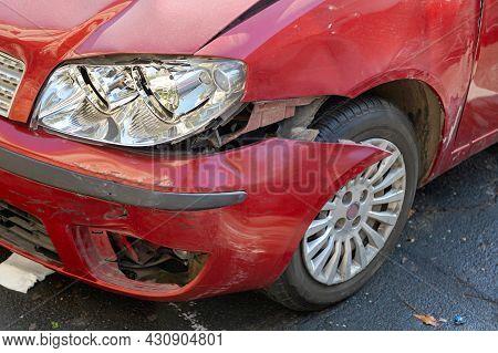Broken Headlight And Bumper At Small Car Front