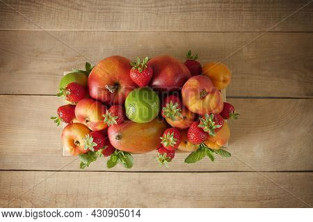 Fresh Fruits. Healthy Food. Mixed Fruit, Apricots And Peaches. Various Fruits On An Old Wooden Table
