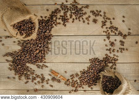 Coffee Beans In A Mug, A Cup Of Coffee Full Of Coffee Beans, Coffee Cup With Roasted Beans On A Wood