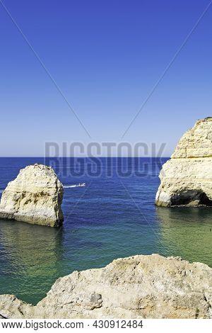 Carvalho Beach In Carvoeiro, Lagoa, Algarve, Portugal. Vertically