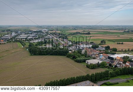 Diksmuide, Flanders, Belgium - August 3, 2021: Aerial View On Wide Agricultural Landscape Nw Of Ijze