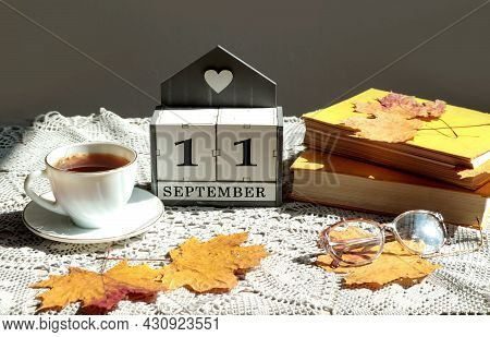 Calendar For September 11 : The Name Of The Month In English, Cubes With The Number 11, A Cup Of Tea
