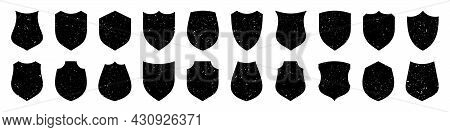 Set Of Various Vintage Shield Icons. Black Heraldic Shields With Grunge Texture. Protection And Secu