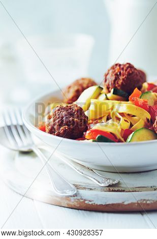 Pappardelle Pasta With Meatballs And Fresh Basil On Bright Background. Close Up.