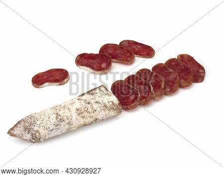Traditional Spanish Fuet Thin Dried Sausage With Slices, Close-up, Isolated On A White Background
