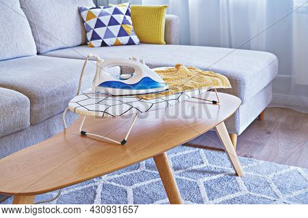 Iron For Ironing On Small Tabletop Ironing Board In Cozy And Living Room, Small Apartments
