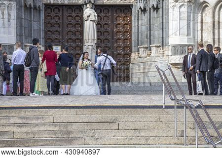 Beautiful View Of Wedding Couple And Their Photographer And Guest's. Sweden. Uppsala. 08.21.2021.
