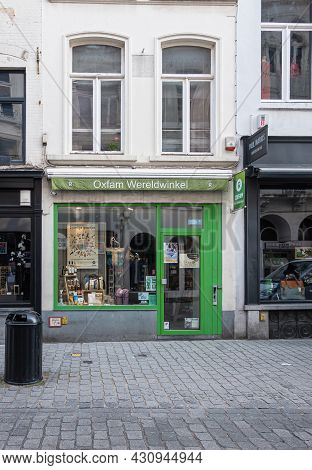 Brugge, Flanders, Belgium - August 4, 2021: Green Small Oxfam Wereldwinkel Facade In Geldmuntstraat