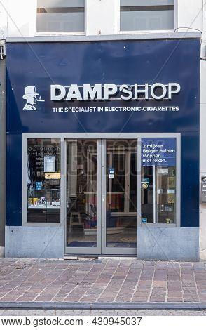Brugge, Flanders, Belgium - August 4, 2021: Blue Facade Of Dampshop In Steenstraat, Specialist In El