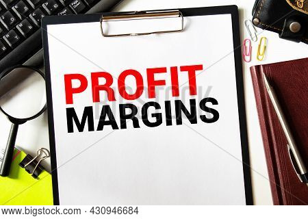 Closeup On Businessman Holding A Card With Text Profit Margin, Business Concept Image With Soft Focu