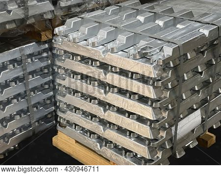 Aluminum Ingots Stacked On A Pallet, Raw Material, Aluminum Alloy Ready To Be Processed, Horizontal