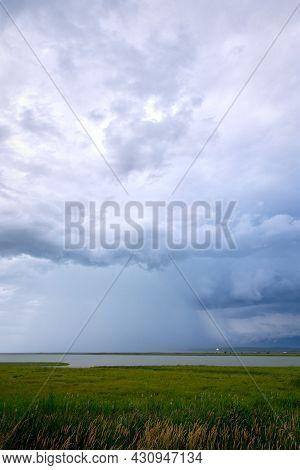 Heavy Rain Over Georgia Strait. Storm Clouds And Heavy Rain Over The Fraser River And The Strait Of