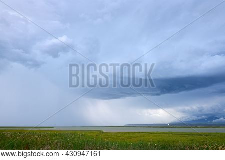 Storm Clouds Over Georgia Strait. Storm Clouds And Rain Over The Fraser River And The Strait Of Geor