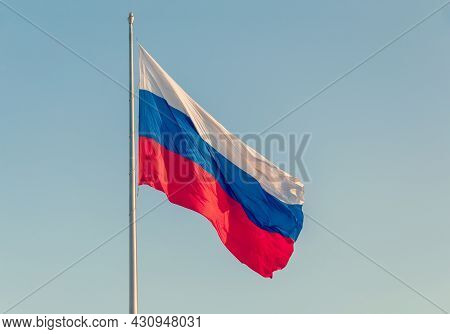 Waving Flag Of The Russian Federation Against The Blue Sky