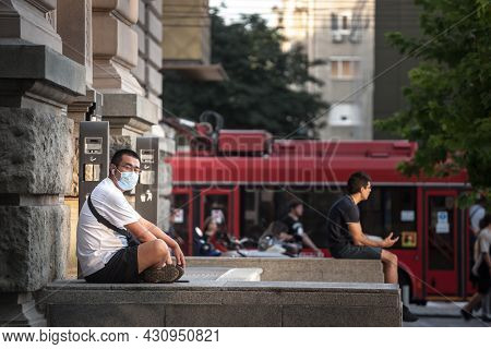 Belgrade, Serbia - August 4 , 2021: Young Asian Man, Chinese, Tourist, Wearing A Respiratory Face Ma