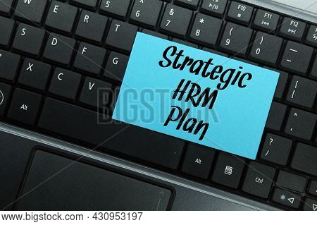 Laptop Keyboard, Colored Paper With The Word Strategic Hrm Plan