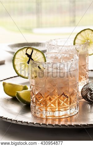 Close Up Of A Margarita Cocktail With A Salted Rim And Garnished With A Slice Of Lime.