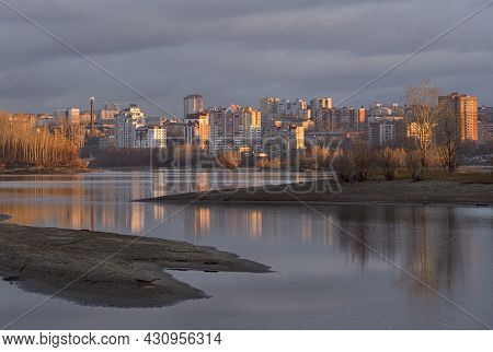 The City Of Novosibirsk Is Lit By The First Rays Of The Rising Sun. River Ob With Sandy Shores And I