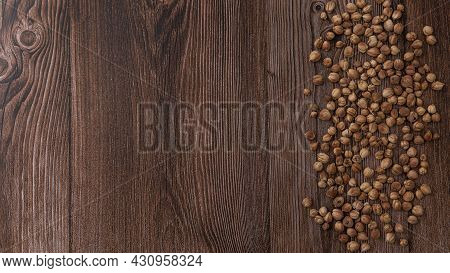 Top View Macro Close-up On Plenty Of Dry Cardamom Spice On Wooden Background, Horizontal Format, Wit
