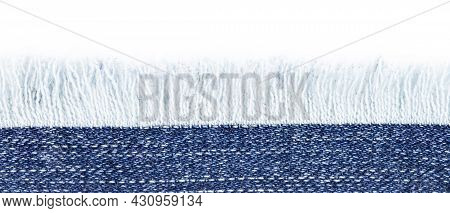 Blue Denim Border With Fringes Close-up, Place For Text, Copy Space.