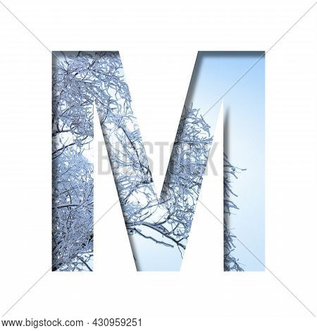 Winter Letters. The Letter M Cut Out Of Paper On The Background Of The Winter Sky And Snow-covered T