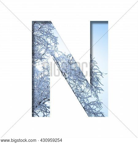 Winter Letters. The Letter N Cut Out Of Paper On The Background Of The Winter Sky And Snow-covered T