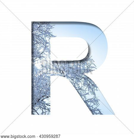 Winter Letters. The Letter R Cut Out Of Paper On The Background Of The Winter Sky And Snow-covered T