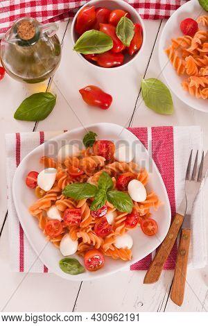 Fusilli Pasta With Cherry Tomatoes And Mozzarella Cheese.