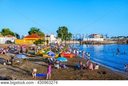 Mazarron, Spain - July 27, 2021: Some people are enjoying in the Bahia beach, also known as Reya beach, in Puerto de Mazarron, Mazarron, in the Costa Calida coast, Spain