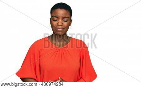 Young african american woman wearing casual clothes with hand on stomach because indigestion, painful illness feeling unwell. ache concept.
