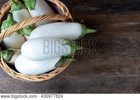 Harvest White Eggplants On A Wooden Background With Place For Text. Eggplant Vegetable On The Table.