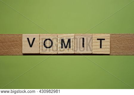 Gray Word Vomit From Small Wooden Letters On A Green Table
