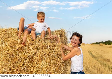 Young Adult Attractive Beautiful Mom With Little Son And Daughter Enjoy Having Fun Fooling Around Si