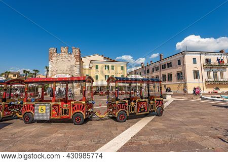 Bardolino, Italy - May 26, 2021: Small Red Tourist Train In Bardolino Village To Take A Sightseeing