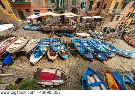 Riomaggiore, Italy - July 8, 2021: Large Group Of Small Boats Moored In The Famous Riomaggiore Villa