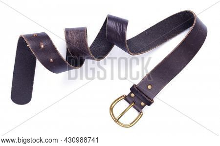 Dark leather belt isolated on white background. Old shabby belt with buckle