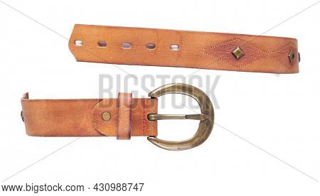 Brown leather belt isolated on white background. Old shabby belt with buckle