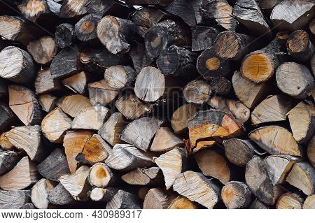 Close Up Stack Of Dry Firewood Wooden Logs, Chopped, Split And Organized In A Pile For Winter Fuel S