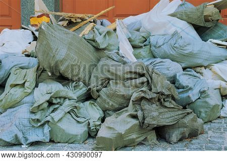 Construction Garbage After Building Repair In Bags. Removal Of Debris. Bunch Of Trash For Utilize.