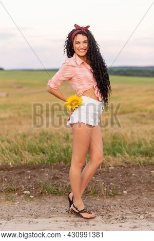 Portrait Of A Woman With A Sunflower In Her Shorts Pocket