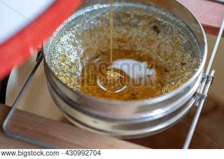 Drop Of Bee Honey Drip From Hexagonal Honeycombs