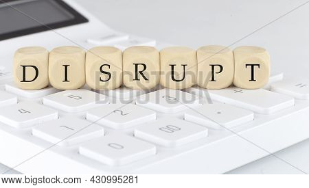 Wooden Cubes With Text Disrupt On The Calculator, Business