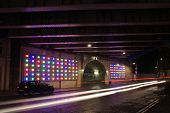 A long exposure of a railway underpass in London Bridge at night. poster