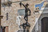 Benvenuto Cellinii??s 1545 bronze sculpture of Perseus with the Head of Medusa At Piazza della Signoria located in Florence Italy poster