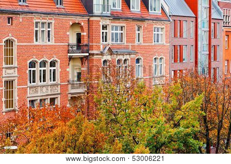 brick facade of residential building of 19th century in Berlin in autumn poster