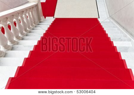 Red Carpet On White Marble Staircase